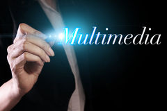 Multimedia. Hand writing multimedia on virtual screen royalty free stock photography