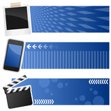 Multimedia Horizontal Banners. A collection of three multimedia horizontal banners with a polaroid frame, a cell phone and a movie clapboard on blue background Royalty Free Stock Images