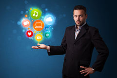 Multimedia icons in the hand of a businessman Stock Photos