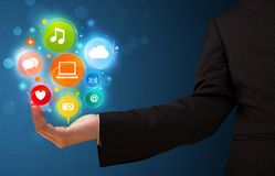 Multimedia icons in the hand of a businessman Stock Photo