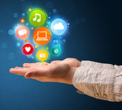 Multimedia icons in the hand of a woman Royalty Free Stock Image
