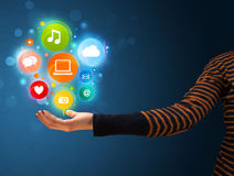Multimedia icons in the hand of a woman Royalty Free Stock Photo
