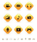 Multimedia icons on yellow rhombus buttons Stock Photos