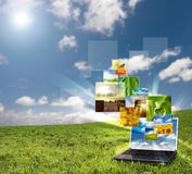 Multimedia laptop. Multimedia concept with modern laptop on green field royalty free stock photos