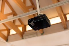 Multimedia projector inside lecture hall. Closeup photo stock photo