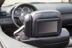 Multimedia screen in a luxury car Stock Photography