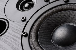 Multimedia speaker. System with different speakers closeup over black background royalty free stock images