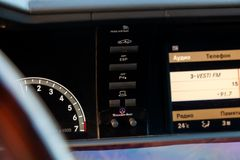 Multimedia system control buttons on the central panel in the interior of the vehicle and the display on which shows the symbols royalty free stock photography