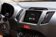 Multimedia system with phone calling on screen in the car Stock Image