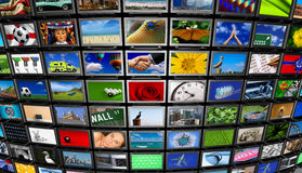 Multimedia Wall. Big installation of Flat Panel TVs displaying different images Royalty Free Stock Photo