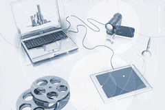 Multimedia workspace. Illustration of a laptop computer, a video camera, film reels and touch pad Stock Photos