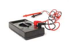 Multimeter. Black multimeter with black and red probes over white background Royalty Free Stock Images