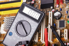 Multimeter. Electronic equipment, multimeter, microcircuit, mother board Stock Images