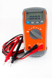 Multimeter. The orange multimeter is photographed on a white background Royalty Free Stock Photos