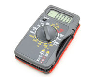 Multimeter of black color. With a red and black wire on a white background Royalty Free Stock Photo