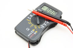 Multimeter of black color. With a red and black wire on a white background Royalty Free Stock Photos