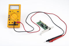 Multimeter and circuit board Royalty Free Stock Photo