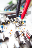 Multimeter on circuit board Royalty Free Stock Image