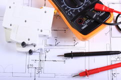 Multimeter and electric fuse on construction drawing stock image