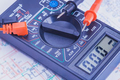 Multimeter on the electrical circuit. close-up Stock Images