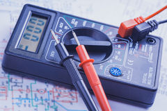 Multimeter on the electrical circuit. close-up Royalty Free Stock Images