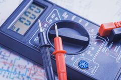 Multimeter on the electrical circuit. close-up Stock Image