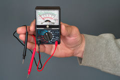 Multimeter in a hand Stock Photo
