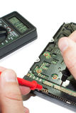 Multimeter and hard disc Stock Photos