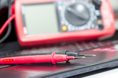 Multimeter on the laptop Stock Image