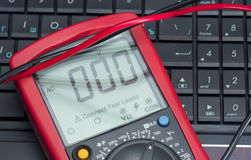Multimeter on the laptop Stock Photos
