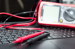 Multimeter on the laptop Stock Images