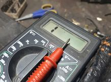 A multimeter or a multitester is an electronic measuring instrument. stock photography