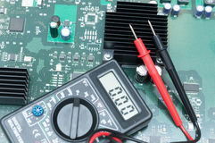 Multimeter on PCB plate. Stock Images