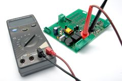Multimeter and printer circuit board. Isolated multimeter and printer circuit board for testing Stock Image