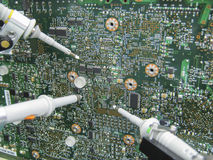 Multimeter probes examining a circuit board. Multimeter probes examining a PCB circuit board Royalty Free Stock Images