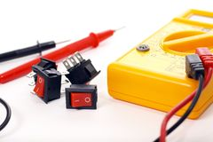 Multimeter and switches, focus on switches Stock Image