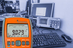 Multimeter on workplace Royalty Free Stock Photo
