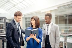 Multinational, business team having discussion on note in office. Friendly multinational, business team having discussion on note in office Royalty Free Stock Photos
