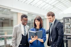 Multinational, business team having discussion on note in office. Friendly multinational, business team having discussion on note in office Royalty Free Stock Photography