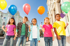 Multinational children with balloons standing Royalty Free Stock Photos