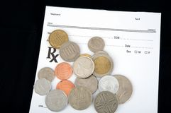 Multinational coins over prescription Royalty Free Stock Photography