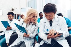 Doctor`s Writing On Papers. Discussion Concept. stock photography