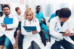 Doctor`s Writing On Papers. Discussion Concept. stock photos