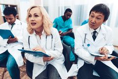 Doctor`s Writing On Papers. Discussion Concept. royalty free stock images