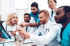Multinational Doctors. X-ray Patient`s Results. stock photos