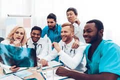 Multinational Doctors. X-ray Patient`s Results. royalty free stock photos