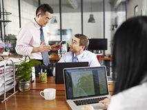 Multinational executives discussing business in office Stock Photo