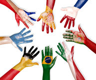 Multinational Flags Drawn on Hands Stock Photography