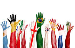 Multinational Flags Drawn on Raised Hands Royalty Free Stock Photography