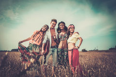 Multinational hippie friends in a wheat field.  Royalty Free Stock Photography